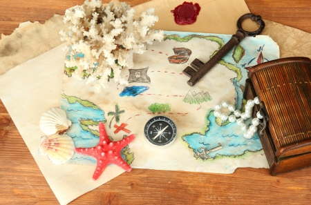 map of treasures on wooden background Stock Photo - 17140305
