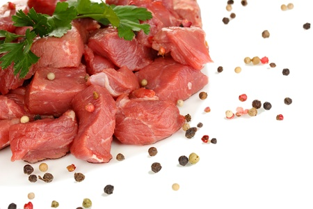 microelements: Raw beef meat isolated on white