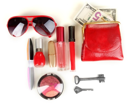 Items contained in the women's handbag isolated on white Stock Photo - 17046779