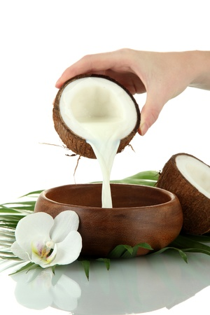 Coconut with coconut milk and leaves, isolated on white photo