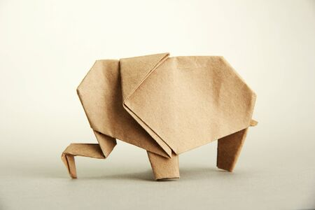 Origami elephant, on grey background photo