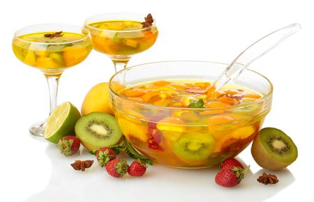 punch in bowl and glasses with fruits, isolated on white photo