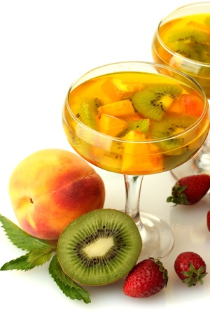 punch in glasses with fruits, isolated on white photo