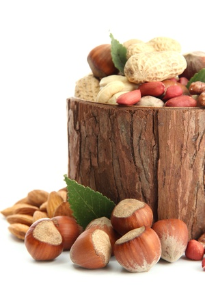 assortment of tasty nuts with leaves in wooden vase, isolated on white Stock Photo - 17053953