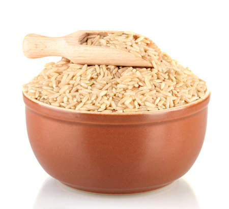 brown rice in a brown plate , isolated on white Stock Photo - 17053643