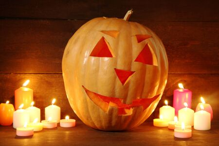 halloween pumpkin and candles, on wooden background Stock Photo - 17054288
