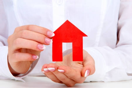concept: woman hands with paper house, close up Stock Photo - 17053890