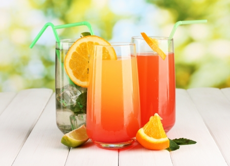 Three cocktails on wooden table on bright background Stock Photo - 17054085