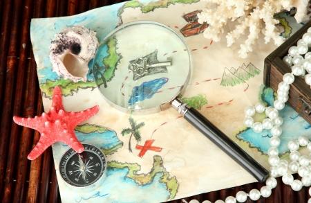 map of treasures on dark wooden background Stock Photo - 17054633