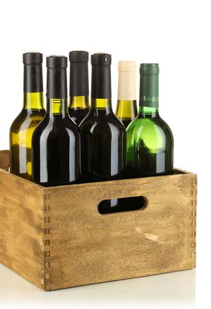 Wine bottles in wooden box isolated on white photo