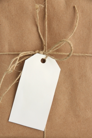 wrapped up: parcel box with kraft paper, close up