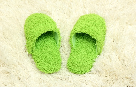 bright slippers, on carpet background Stock Photo - 17054385