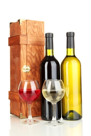 Wooden case with wine bottles isolated on white photo
