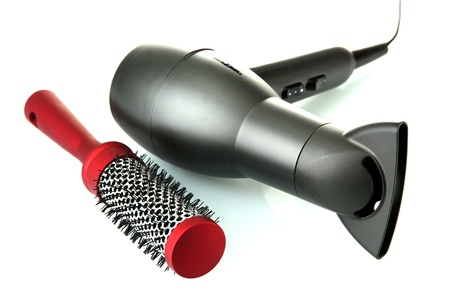 hair dryer and comb brush, isolated on white photo