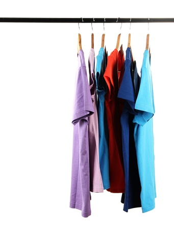 clothing rack: Choice of clothes of different colors on wooden hangers, isolated on white