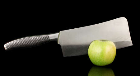 tastyhealth: Green apple and knife isolated on black Stock Photo