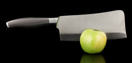 Green apple and knife isolated on black Stock Photo - 17053461
