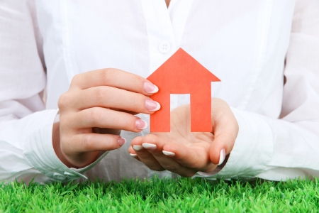 concept: woman hands with paper house, close up Stock Photo - 17084206