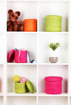 Color wicker boxes on cabinet shelves Stock Photo - 17084142