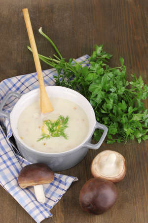 nutritiously: Mashed potatoes in saucepan with ingredients on wooden table Stock Photo