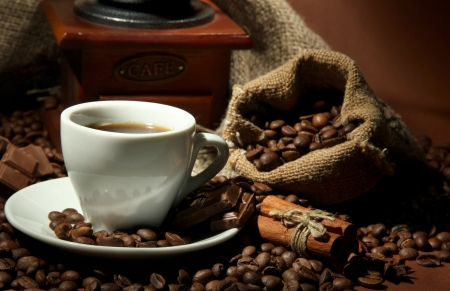 cup of coffee, grinder, turk and coffee beans on brown background Stock Photo - 17086577