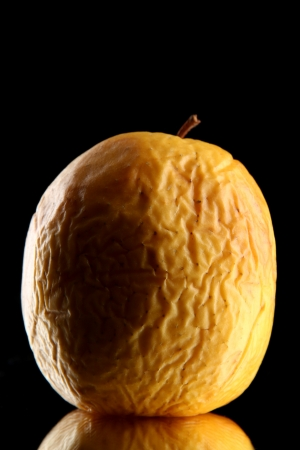 Yellow apple as problem skin concept, on black background Stock Photo - 17110500