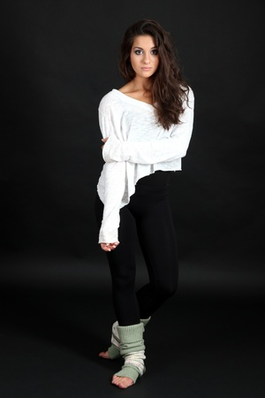 young modern dancer  posing, isolated on black photo