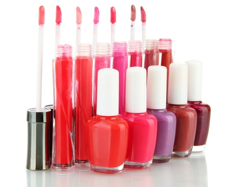 glosses: beautiful lip glosses and nail polish bottles, isolated on white Stock Photo