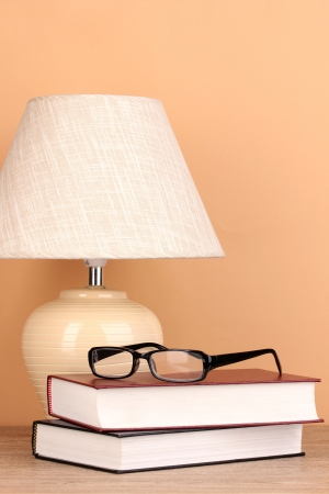 table lamp and books on beige background Stock Photo - 17111052