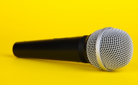 electronic voting: Black microphone on yellow background