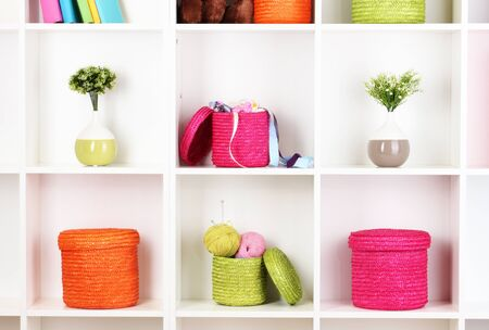 Color wicker boxes on cabinet shelves Stock Photo - 17110822