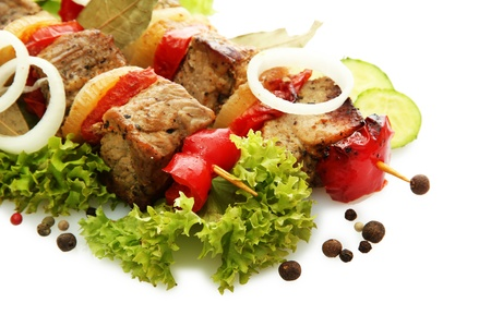 tasty grilled meat and vegetables on skewers, isolated on white Stock Photo - 17110838