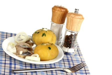 Dish of herring and potatoes on plate isolated on white photo