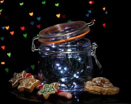 Christmas lights in glass bottle on blur lights background photo
