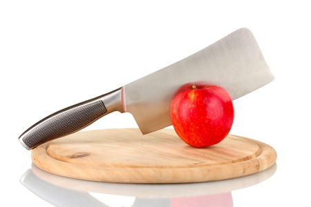 Red apple and knife on cutting board, isolated on white Stock Photo - 17133093
