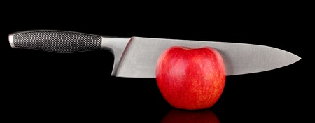 Red apple and knife on isolated on black Stock Photo - 17133033
