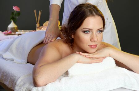 beautiful young woman in spa salon getting massage, isolated on white Stock Photo - 17195000