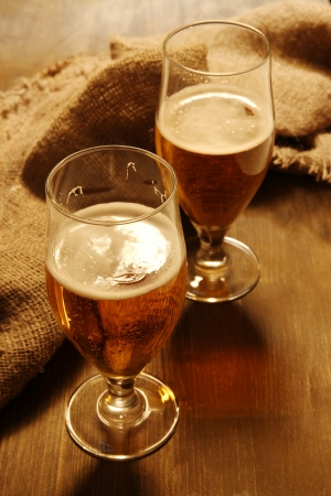 Glasses of beer on wooden table close-up Stock Photo - 17138308