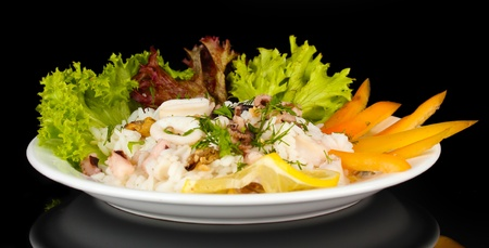 Delicatessen seafood salad with rice isolated on black Stock Photo - 17137839