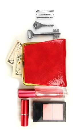 Items contained in the women's handbag isolated on white Stock Photo - 17138004