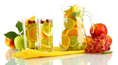 transparent jar and glasses with citrus fruits, isolated on white Stock Photo - 17138511