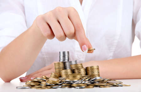 Woman hands with coins, close up Stock Photo - 17139085