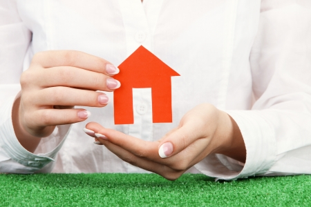 concept: woman hands with paper house, close up Stock Photo - 17138814