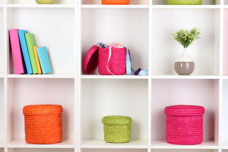 Color wicker boxes on cabinet shelves Stock Photo - 17139293