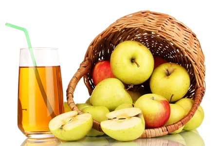Useful apple juice with apples around in basket isolated on white photo