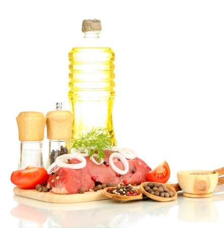 microelements: Raw beef meat marinated with herbs, spices and cooking oil isolated on white Stock Photo