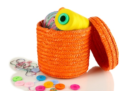 Orange wicker basket with accessories for needlework isolated on white Stock Photo - 17138807