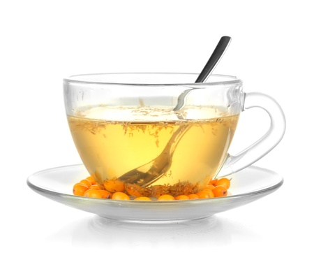 buckthorn: buckthorn broth in a glass cup isolated on white