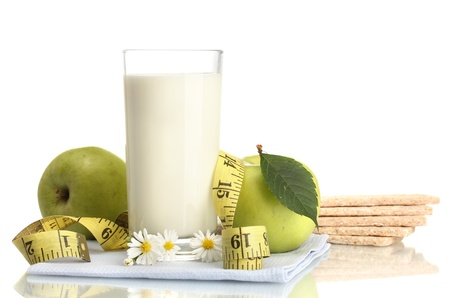 Glass of kefir, green apples, crispbreads and measuring tape isolated on white Stock Photo - 17184082