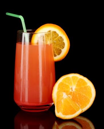 longdrink: Glass of orange cocktail isolated on black